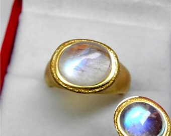 AAA Blue Rainbow Moonstone   11x9mm  3.44 Carats   in Ladies 18K Yellow gold cocktail ring 10 grams. 2636
