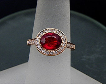 AAA Ruby 7.7x6.0mm 1.50 Carats Oval 14K Rose gold Halo engagement ring with .30cts of diamonds. 784