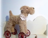 A large mohair Terrier on vintage Meccano wheels