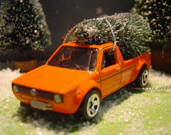 VW Caddy Pickup Truck with Christmas tree ornament