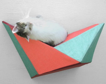 Cat shelf wall bed in coral, mint, rust & green