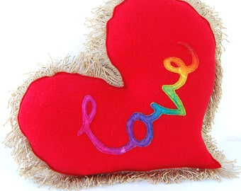 Red, Gold and Rainbow Love Heart Cushion - A Super Cute and Unique Felt and Tassle Trim Love Heart Pillow with the word love in rainbow