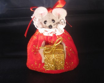 Christmas Lady Mouse Holding a Present