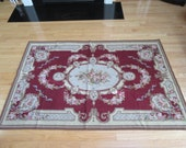 Very nice hand stitched large floral needlepoint rug with turned and hand stitched edges- looks like never used on floor, gorgeous
