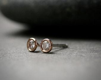 Tiny bezel set 14k rose gold and round brilliant cut moissanite stud earrings 3mm quarter carat
