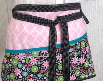 Vendor apron with zippered pocket black and pink floral