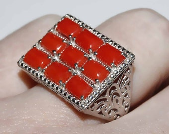 Untreated Mediterranean coral ring set in sterling filligree and platinum setting size 7 shipping included U.S.A and Canada
