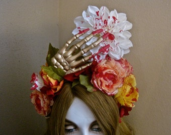 Painting the Flowers: Day of the Dead Halloween Headpiece Macabre Bloody Skeleton Hand and Colorful Flowers Gory Blood Red Drop
