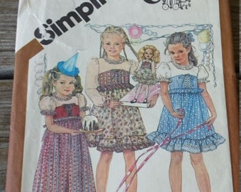 1980's Girl's dress in Two lenghts and Dress for the Kimberly Doll and other 15-17 inch dolls Pattern 5256  size 6