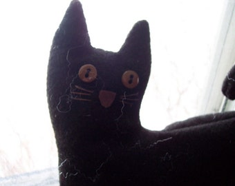 Primitive cat doll made from black felt and stuffed with polyster fiber fill