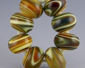 set of 8 donut or rondelle beads in shades of brown handmade lampwork glass swirled colors - Arizona Desert