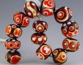13 rondelle beads in light and dark red plus white layered dot designs no two alike handmade lampwork glass - Red for Summer