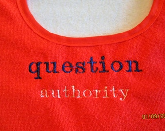 "Machine embroidered lettering that says ""Question Authority"""