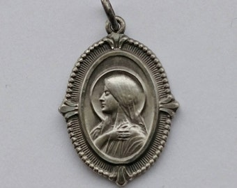 Vintage Catholic Veiled Mary  Sacred Heart of Jesus on back  Stamped Sterling Pendant American made