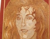 Cher. Hollywood star Cher portrait handmade with rice leaves. Sonny & Cher fame  No color, paint or dye added the natural color of rice leaf