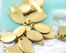 Oval Brass Logo Tags 5x9mm ONE Ring - 20