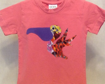 Organic cotton toddler t-shirt designed with a Pelican