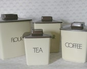 1970s plastic canisters for flour sugar coffee and tea with tan bottom and brown lid