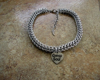 "Gypsy Soul Chainmail Boot Bracelet 12"" long, made with 1/4"" aluminum jump rings, a metal charm with a lobster clasp and 2"" extender chain."