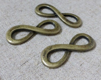 free shipping in UK - pack of 10  - Alloy Tibetan Style Infinity Links, 34x13x4mm Bronze connector