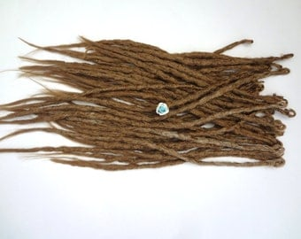 38 Dark Blonde synthetic dreads. Synthetic dreads, dreadlocks, dreads, synthetic dreadlocks, dreadlock extensions, long thin single ended