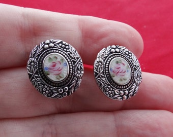 "Vintage silver tone screw .75"" earrings with floral enameled center in great condition"