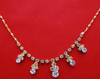 """Vintage 17"""" gold tone necklace with rhinestones in great condition, appears unworn"""