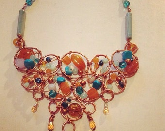 Copper Wire wrapped bib style necklace oranges and blues