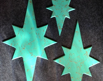 set of three atomic starburst wall hangings