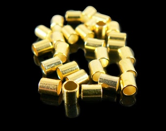 """2mm inside diameter, size 4 gold plated crimp tubes, 2 grams (~ 42- 44 pcs). 2.5mm wide by 3mm high. Use with .030"""" wire. Large crimps"""
