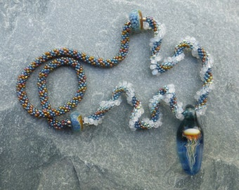 Hand Crocheted Jellyfish on a Wave Necklace aqua