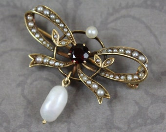 Antique Edwardian 14K Yellow Gold Garnet and Seed Pearl Teardrop Bow Brooch