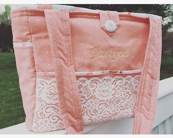 Diaper bag- large bag- in coral dot fabric with lace detail, embroidered name and floral interior.