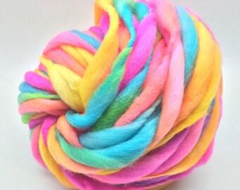 Handspun rainbow yarn, 50 yards and 3.3 ounces, 94 grams, spun super chunky, thick and thin in merino wool