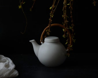 Dark Still Life with White Teapot and Forsythia Branches