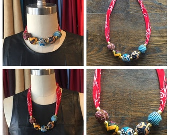 One of a kind bandana choker/necklace with handmade African wax print fabric covered beads.