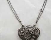Antique Silver Chinese Repousse Dragon Pendant
