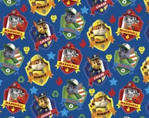 Paw Patrol Badge on blue - Cotton Print Fabric by David Textiles - you choose the cut