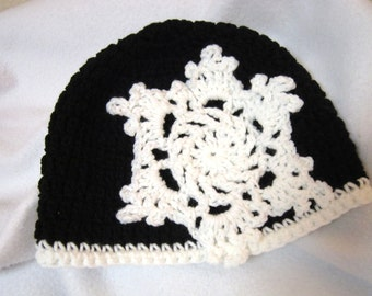 Crochet Black Beanie Cap with Large White Snowflake, Womens Winter Wear by Crocheted by Charlene