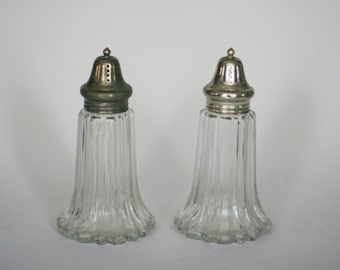 vintage glass salt and pepper shakers with silver tops made in japan