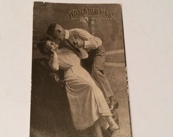 "Antique Postcard - ""What's in a Kiss?"""