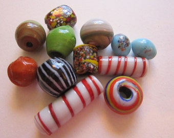 12 glass beads - spatter glass, striped, swirled - focal beads - 1/2 to 1.5 inches