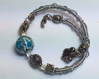 Memory Wire Bracelet with Teal and Gray Ceramic Bead and Charms