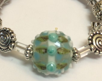 Memory Wire Bracelet with Teal and White Glass Bead and Charms