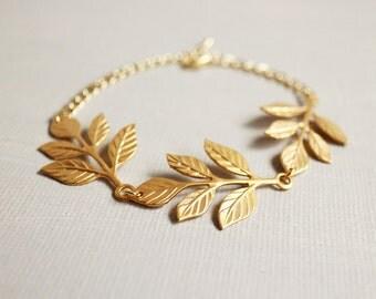 Gold Leaves Bracelet. matte gold leaves bracelet. triple leaves bracelet. fall autumn harvest bracelet. holiday jewelry. bridesmaid bracelet
