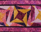 Bright Bold Batik quilted table runner/wall hanging in pinks purples fuchsias gold