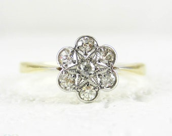 Antique Diamond Cluster Ring, Daisy Flower Shape 7 Stone Engagement Ring with Star Design. 18 Carat & Platinum, Circa 1910s.
