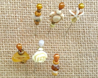 Designer beaded pins for your pinboard made with a collection including a turtle, starfish, rose and lots of yellows, off whites and golds