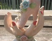 Vintage porcelain hand painted hand holding shoe