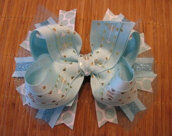 2327 light aqua with gold arrows double ribbon boutique bow with tulle and spikes